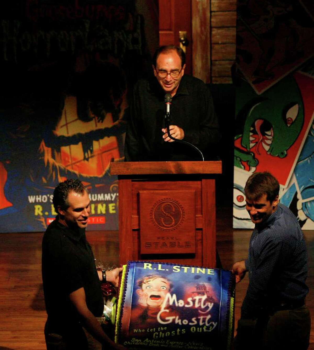 Author R.L. Stine is presented with a birthday cake before a speech to the audience during the Express-News Children's Book & Author Celebration at Pearl Stable, benefiting the S.A. Public Library Foundation's Born to Read program on Oct. 8, 2011.