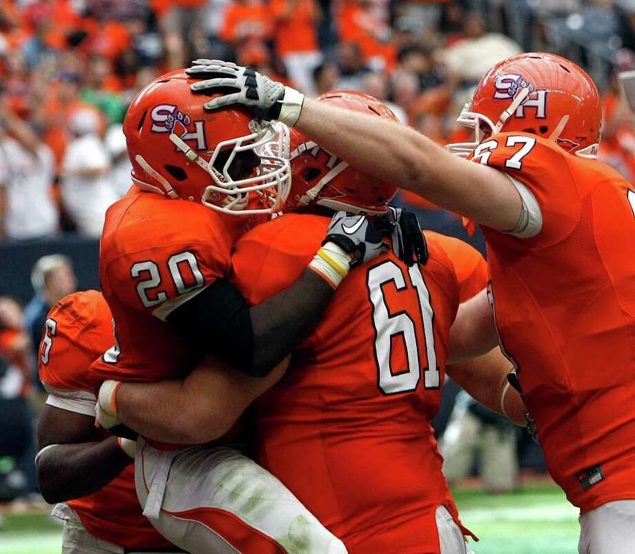 Oct. 8: SHSU 45, SFA 10 SHSU's Tim Flanders celebrates his touchdown at Reliant Stadium. Photo: Johnny Hanson, Houston Chronicle / © 2011 Houston Chronicle