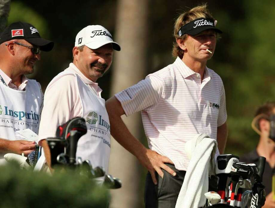 Brad Faxon (right) waits to tee off on No. 12 during the second round of the Insperity Classic, Saturday, October 8, 2011 at the Tournament Course in The Woodlands, TX. Faxon is the tournament leader at -10, one shot better than Tommy Armour III. Photo: Eric Christian Smith, For The Chronicle