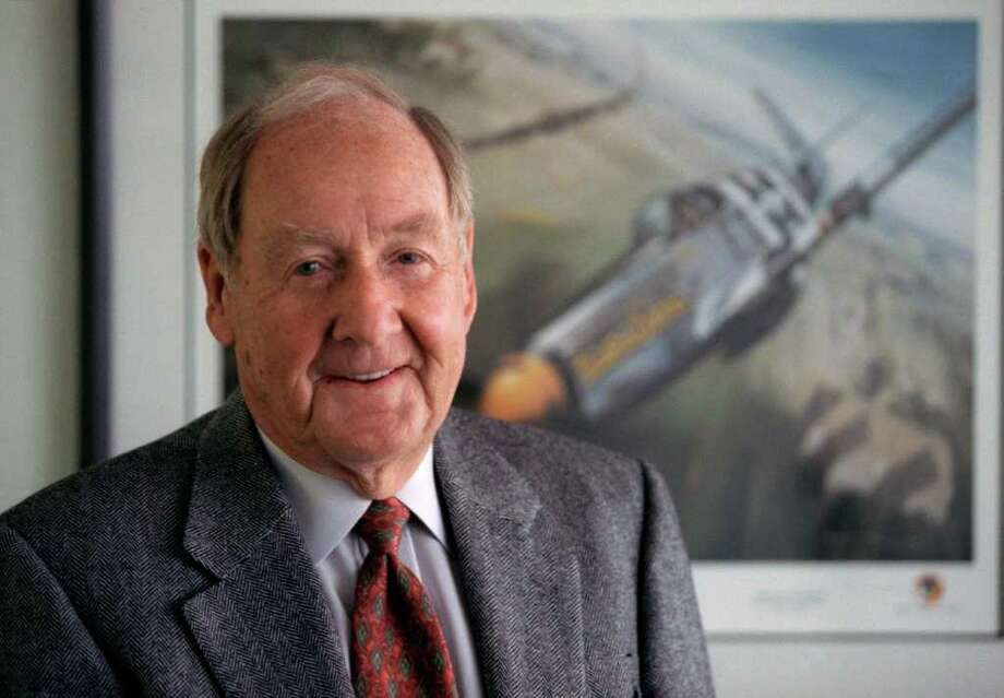 In this April 1998 photo,Ken Dahlberg stands in front of a painting of a Mustang fighter he flew in WWII in St. Louis Park, Minn. Minnesota businessman Kenneth Dahlberg, an inadvertent figure in the Watergate scandal that brought down Richard Nixon's presidency, has died. He was 94. (AP Photo/The Star Tribune, Tom Sweeney)  MANDATORY CREDIT; ST. PAUL PIONEER PRESS OUT; MAGS OUT; TWIN CITIES TV OUT Photo: Tom Sweeney / The Star Tribune