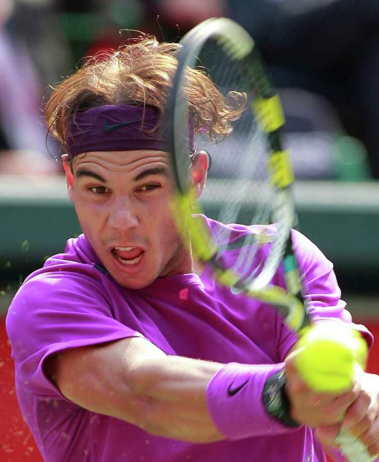 Rafael Nadal of Spain returns the ball to Mardy Fish of the U.S. during their semifinal match at the Japan Open tennis tournament in Tokyo, Japan, Saturday, Oct. 8, 2011. Nadal won, 7-5, 6-1. (AP Photo/Itsuo Inouye) Photo: Itsuo Inouye / AP