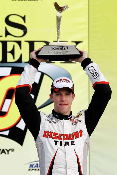 KANSAS CITY, KS - OCTOBER 08:  Brad Keselowski, driver of the #22 Discount Tire Dodge, poses in Victory Lane after winning the NASCAR Nationwide Series Kansas Lottery 300 at Kansas Speedway on October 8, 2011 in Kansas City, Kansas.  (Photo by Todd Warshaw/Getty Images for NASCAR) Photo: Todd Warshaw / 2011 Getty Images