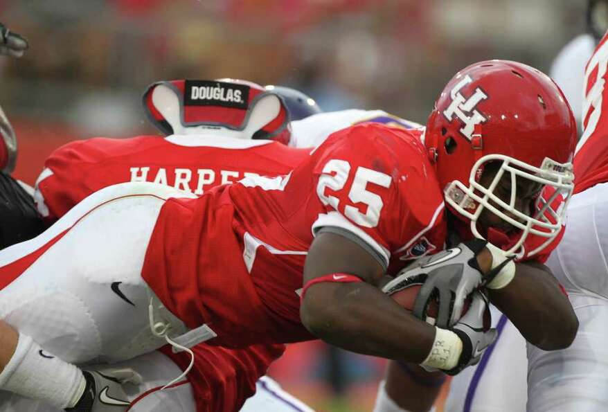 University of Houston running back Bryce Beall (25) lunges forward for a touch downon the East Carol
