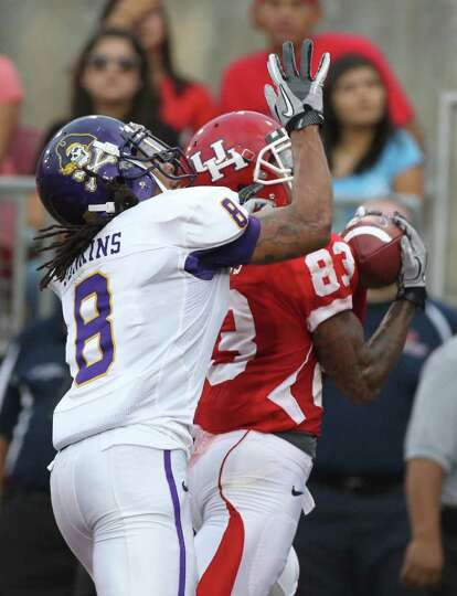 East Carolina University defensive back Jacobi Jenkins (8) can't stop University of Houston wide rec