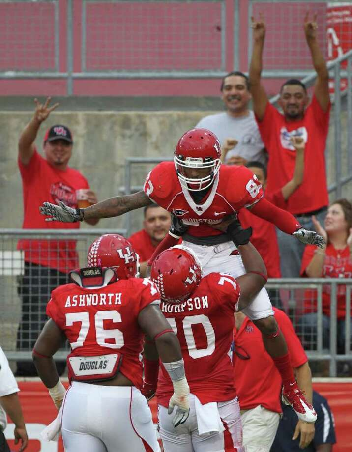 University of Houston wide receiver Patrick Edwards (83) celebrates his touch down catch with University of Houston offensive linesman Chris Thompson (70) in the first quarter of a NCAA football game at Robertson Stadium on Saturday, Oct. 8, 2011, in Houston. Photo: Nick De La Torre, Houston Chronicle / © 2011  Houston Chronicle