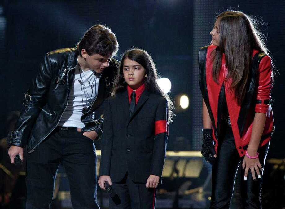 From left, Prince Jackson, Blanket Jackson and Paris Jackson arrive on stage at the Michael Forever the Tribute Concert, at the Millennium Stadium in Cardiff, Saturday, Oct. 8, 2011. (AP Photo/Joel Ryan) EDITORIAL USE ONLY Photo: Joel Ryan / AP