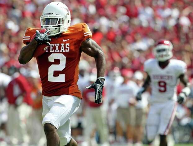 Longhorn running back Fozzy Whittaker takes off on a kick off return for a touchdown as the Texas Longhorns play the Oklahoma Sooners at the Cottom Bowl in the Red River Rivalry   October 8, 2011.  Tom Reel/Staff Photo: TOM REEL, Tom Reel / Treel@express-news.net / © 2011 San Antonio Express-News