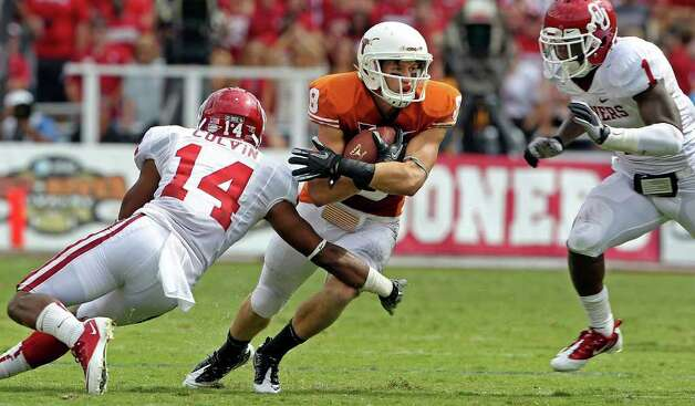 Longhorn receiver Jaxon Shipley tries to get away from Sooner tacklers Aaron Colvin and Tony Jefferson as the Texas Longhorns play the Oklahoma Sooners at the Cottom Bowl in the Red River Rivalry   October 8, 2011.  Tom Reel/Staff Photo: TOM REEL, Tom Reel / Treel@express-news.net / © 2011 San Antonio Express-News