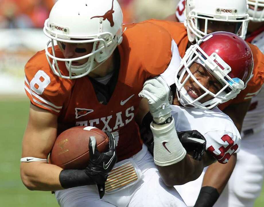 Texas' Jaxon Shipley (08) gets tackled by Oklahoma's Jamell Fleming (32) in the first half at the Red River Rivalry at the Cotton Bowl in Dallas on Saturday, Oct. 8, 2011. Kin Man Hui/kmhui@express-news.net Photo: KIN MAN HUI, Kin Man Hui / Kmhui@express-news.net / SAN ANTONIO EXPRESS-NEWS