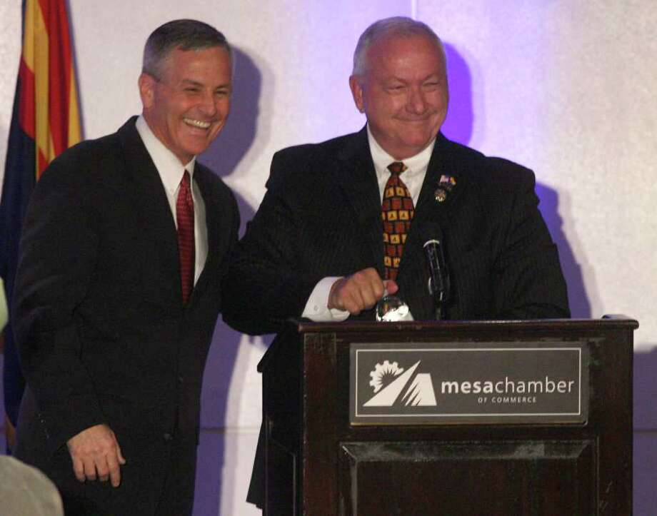 Republicans Jerry Lewis, left, and Arizona Senate President Russell Pearce shake hands after a debate on the campus of East Valley Institute of Technology and put on by the Mesa Chamber of Commerce, Thursday, October 6, 2011 in Mesa. (AP Photo/Tim Hacker - East Valley Tribune) Photo: Tim Hacker / East Valley Tribune