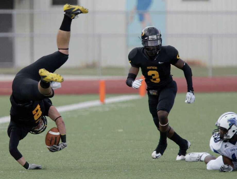 THOMAS B. SHEA: FOR THE CHRONICLE AIR TIME: Panthers receiver Nicky Baratti (2) flips after a tackle by La Darion Williams, right, of the Wildcats in Klein Oak's 38-6 win over visiting Dekaney. Photo: For The Chronicle: Thomas B. She