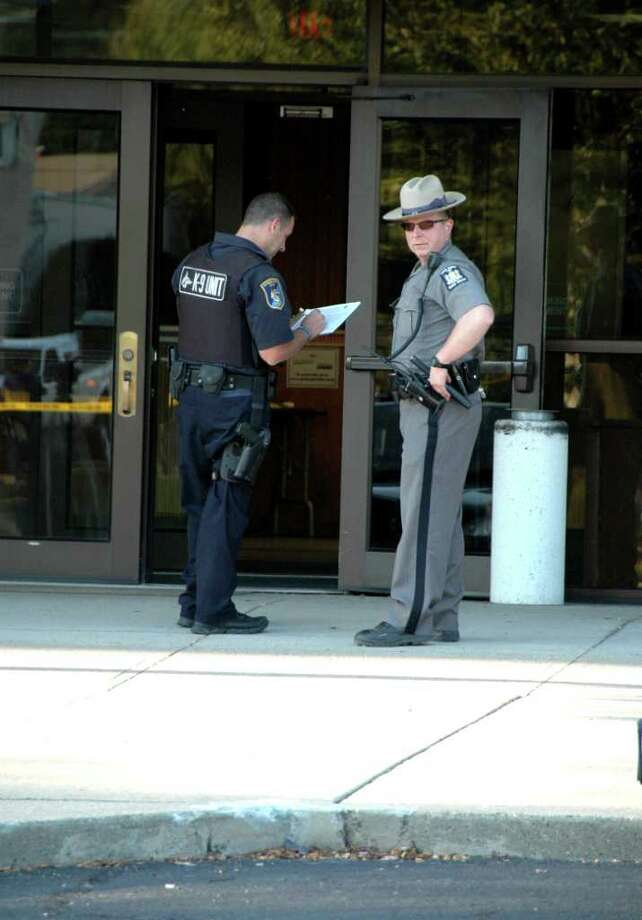 Officials are at the scene of the shooting at the Daily Gazette building in Schenectady Saturday. (Brian.L.Houle I.P.A Photo)