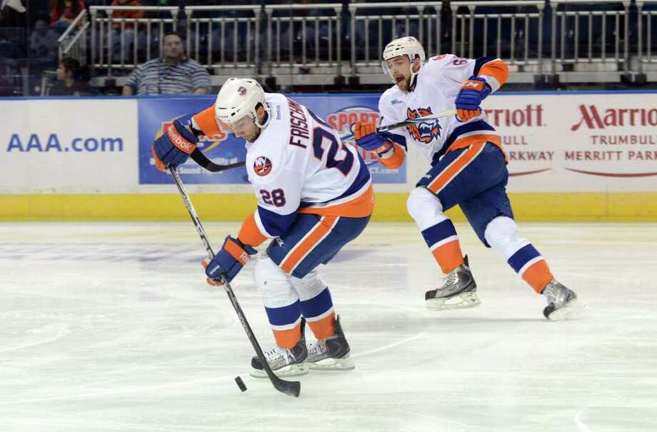 Bridgeport Sound Tigers' Trevor Frischmon controls the puck as teammate Tomas Marcinko watches the play during the AHL season opener against the Portland Pirates at the Webster Bank Arena in Bridgeport on Saturday, Oct. 8, 2011. Photo: Amy Mortensen / Connecticut Post Freelance