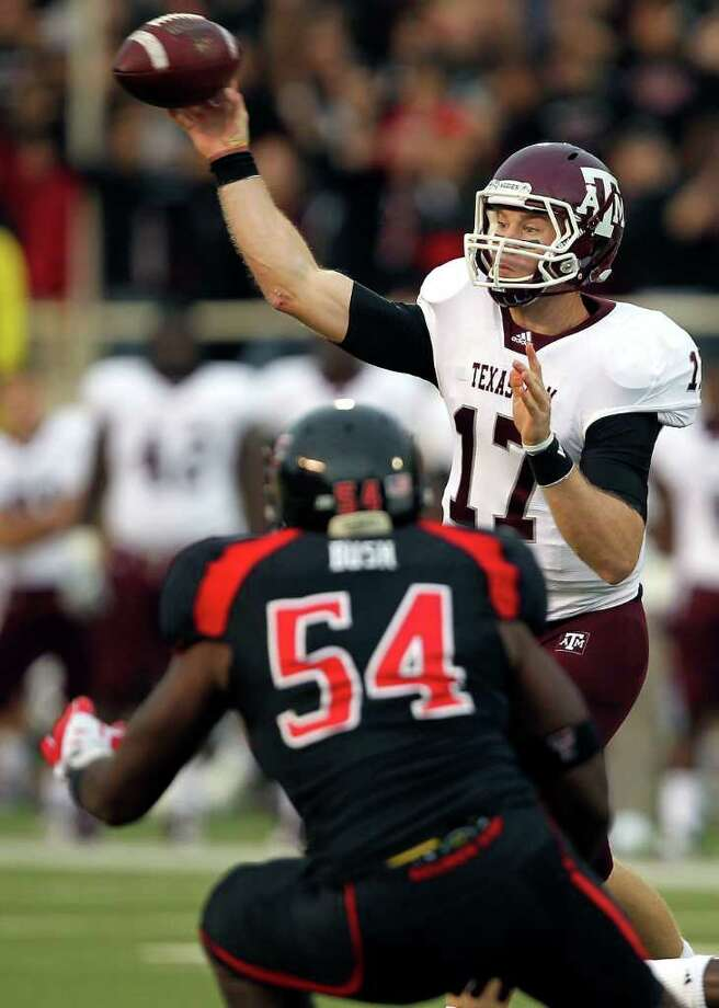 Texas A&M's Ryan Tannehill (17) throws a pass over Texas Tech's Dartwan Bush (54) during an NCAA college football game in Lubbock, Texas on Saturday, Oct. 8, 2011. (AP Photo/The Lubbock Avalanche-Journal, Stephen Spillman) Photo: Stephen Spillman, Associated Press / Lubbock Avalanche-Journal