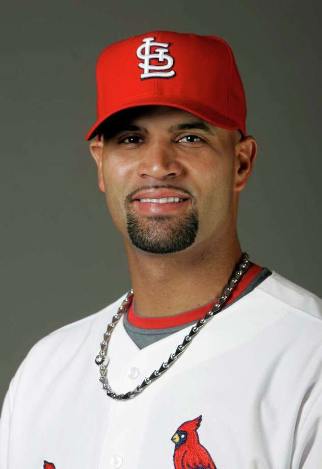 -- FILE -- In this Feb. 20, 2009, file photo,St.Louis Cardinals' Albert Pujols poses for a photograph. Pujols was the leading vote-getter in balloting for the Midsummer Classic announced Sunday, July 5, 2009, by Major League Baseball, giving the Cardinals first baseman the start in his home ballpark. (AP Photo/Jeff Roberson,file) Photo: Jeff Roberson / AP