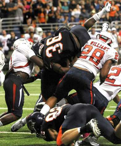 UTSA's Evans Okotcha (36) breaks the plane of the goal line to score a first-half touchdown against Southern Alabama during college football action at the Alamodome on Saturday, Oct. 8, 2011. BILLY CALZADA / gcalzada@express-news.net