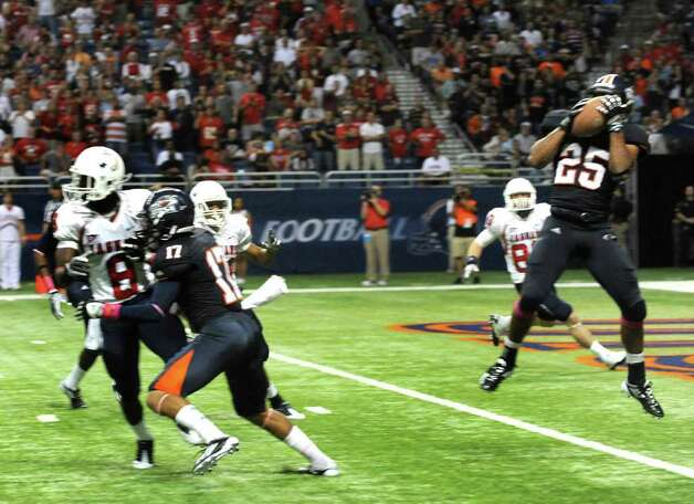 UTSA defensive back Mark Waters (25) intercepts a Southern Alabama pass in the end zone during college football action at the Alamodome on Saturday, Oct. 8, 2011. BILLY CALZADA / gcalzada@express-news.net