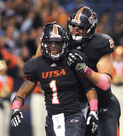 UTSA receiver Kam Jones (1) is congratulated by teammate Sean Luchnick after a long first-half reception against Southern Alabama during college football action at the Alamodome on Saturday, Oct. 8, 2011. BILLY CALZADA / gcalzada@express-news.net