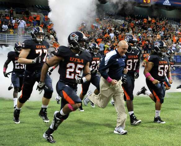 UTSA football coach Larry Coker runs onto the field with his Roadrunners for their game against Southern Alabama at the Alamodome on Saturday, Oct. 8, 2011. BILLY CALZADA / gcalzada@express-news.net