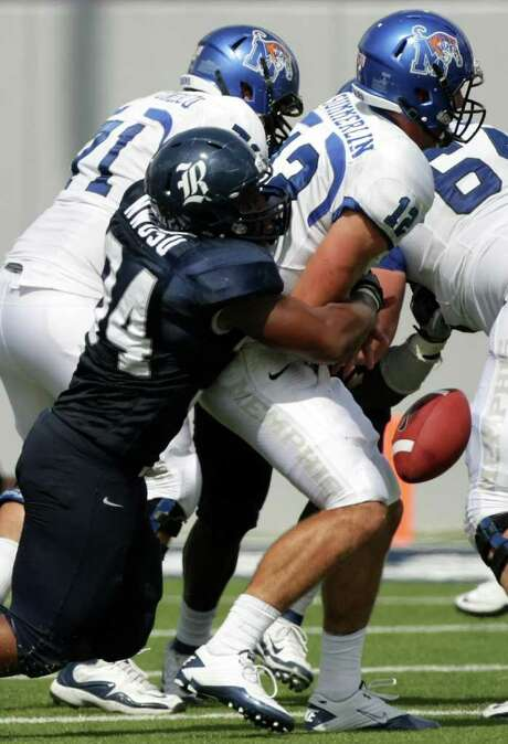NICK de la TORRE: CHRONICLE SQUEEZED: Cameron Nwosu, left, adds to Rice's defensive dominance by forcing a fumble by Memphis' Andy Summerlin. Photo: Nick De La Torre / © 2011  Houston Chronicle