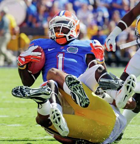 BILL HABER : ASSOCIATED PRESS WHAT A DEFENSE: LSU's Tyrann Mathieu makes sure Florida's Chris Rainey can't get untracked. Photo: Bill Haber / FR170136 AP