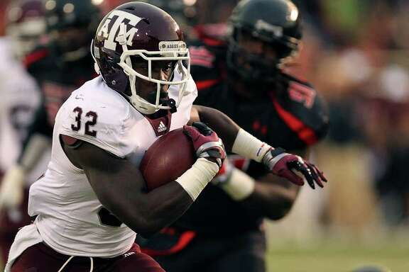 Texas A&M's Cyrus Gray (32) breaks free for a touchdown against Texas Tech during an NCAA college football game in Lubbock, Texas on Saturday, Oct. 8, 2011.