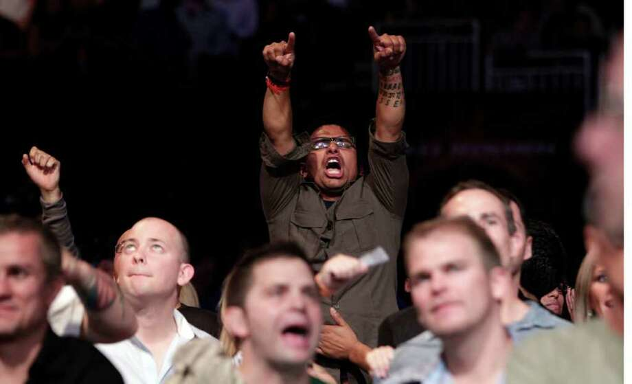 """A fan cheers after Frankie """"The Answer""""  Edgar, knocked out Gray """"The Bully"""" Maynard in the fourth round during the UFC 136 lightweight title bout at Toyota Center Saturday, Oct. 8, 2011, in Houston.  Before tonight Edgar's MMA record was 13-1-1 and 8-1-1 in UFC. Maynards MMA record was 11-0-1 and 8-0-1 in UFC Photo: Johnny Hanson, Houston Chronicle / © 2011 Houston Chronicle"""