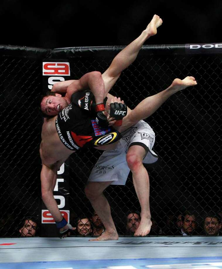 "Chael Sonnen throws down Brian Stann in a middleweight bout where Sonnen won in two rounds before the UFC 136 lightweight title bout with Gray ""The Bully"" Maynard and Frankie ""The Answer""  Edgar at Toyota Center Saturday, Oct. 8, 2011, in Houston. 