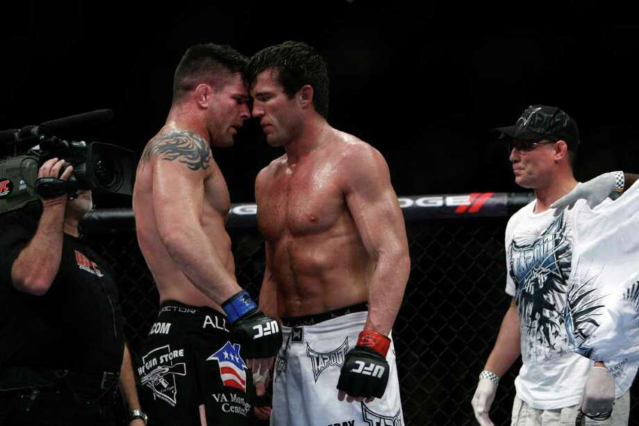 """Chael Sonnen, right, buts heads with Brian Stann in a middleweight bout where Sonnen won in two rounds before the UFC 136 lightweight title bout with Gray """"The Bully"""" Maynard and Frankie """"The Answer""""  Edgar at Toyota Center Saturday, Oct. 8, 2011, in Houston.  Before tonight Edgar's MMA record was 13-1-1 and 8-1-1 in UFC. Maynards MMA record was 11-0-1 and 8-0-1 in UFC Photo: Johnny Hanson, Houston Chronicle / © 2011 Houston Chronicle"""