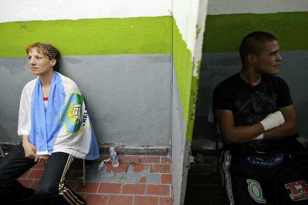 FOR SPORTS - Soledad Mathysse (left) relaxes while waiting for her fight with Jackie Nava at the Auditorio Municipal in Tijuana, Baja California, Mexico Saturday Oct. 8, 2011.  (PHOTO BY EDWARD A. ORNELAS/eaornelas@express-news.net) Photo: EDWARD A. ORNELAS, SAN ANTONIO EXPRESS-NEWS / © SAN ANTONIO EXPRESS-NEWS (NFS)