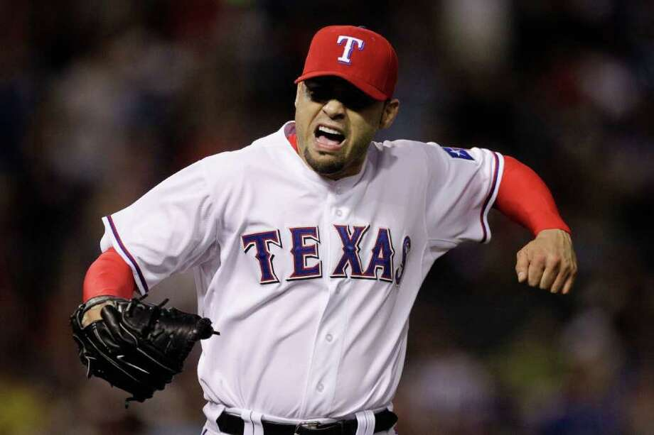 ARLINGTON, TX - OCTOBER 08:  Mike Gonzalez #51 of the Texas Rangers reacts after the final out of the top of the fifth inning against the Detroit Tigers in Game One of the American League Championship Series at Rangers Ballpark in Arlington on October 8, 2011 in Arlington, Texas. Photo: Bob Levey, Getty / 2011 Getty Images