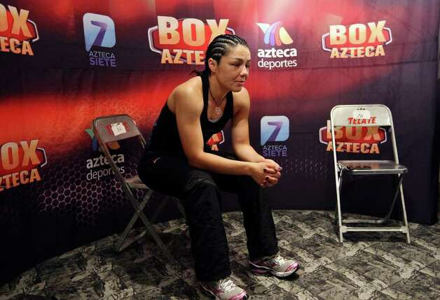 FOR SPORTS - Jackie Nava relaxes while waiting for her fight with Soledad Mathysse at the Auditorio Municipal in Tijuana, Baja California, Mexico Saturday Oct. 8, 2011.  (PHOTO BY EDWARD A. ORNELAS/eaornelas@express-news.net) Photo: EDWARD A. ORNELAS, SAN ANTONIO EXPRESS-NEWS / © SAN ANTONIO EXPRESS-NEWS (NFS)