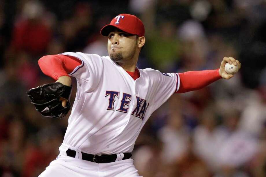 ARLINGTON, TX - OCTOBER 08:  Mike Gonzalez #51 of the Texas Rangers throws a pitch against the Detroit Tigers in Game One of the American League Championship Series at Rangers Ballpark in Arlington on October 8, 2011 in Arlington, Texas. Photo: Bob Levey, Getty / 2011 Getty Images