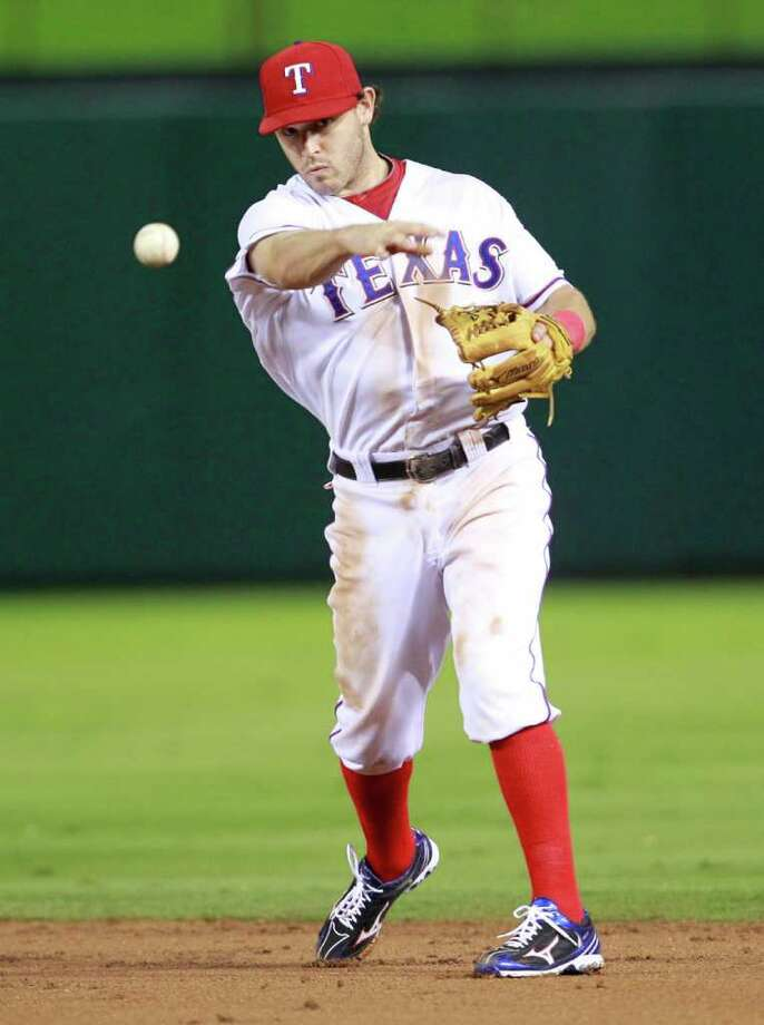 Texas Rangers second baseman Ian Kinsler makes a throw to first base against the Detroit Tigers in Game 1 of the American League Championship Series at the Rangers Ballpark in Arlington, Texas, on Saturday, October 8, 2011. (Ron Jenkins/Fort Worth Star-Telegram/MCT) Photo: Ron Jenkins, McClatchy-Tribune News Service / Fort Worth Star-Telegram