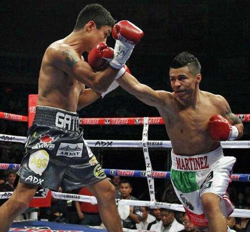 FOR SPORTS - Rodrigo Guerrero (left) and Raul Martinez exchange punches during first round action of their IBF super flyweight title fight held at the Auditorio Municipal in Tijuana, Baja California, Mexico Saturday Oct. 8, 2011.  (PHOTO BY EDWARD A. ORNELAS/eaornelas@express-news.net) Photo: EDWARD A. ORNELAS, SAN ANTONIO EXPRESS-NEWS / © SAN ANTONIO EXPRESS-NEWS (NFS)