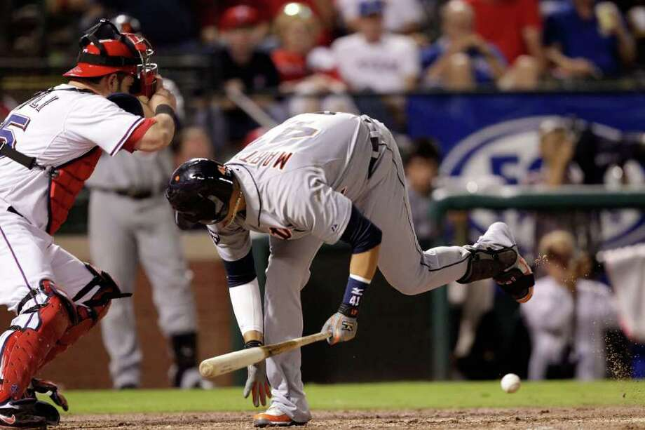 ARLINGTON, TX - OCTOBER 08:  Victor Martinez #41 of the Detroit Tigers dives out of the way of a wild pitch from C.J. Wilson #36 of the Texas Rangers allowing Austin Jackson #14 of the Detroit Tigers to score in the fifth inning of Game One of the American League Championship Series at Rangers Ballpark in Arlington on October 8, 2011 in Arlington, Texas. Photo: Bob Levey, Getty / 2011 Getty Images