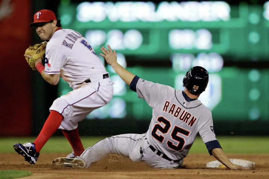 Game 1: Rangers 3, Tigers 2.  Ryan Raburn #25 of the Detroit Tigers slides in out at second as Ian Kinsler #5 of the Texas Rangers turns a double play in the third inning of Game One of the American League Championship Series at Rangers Ballpark in Arlington on October 8, 2011 in Arlington, Texas. Photo: Bob Levey, Getty / 2011 Getty Images