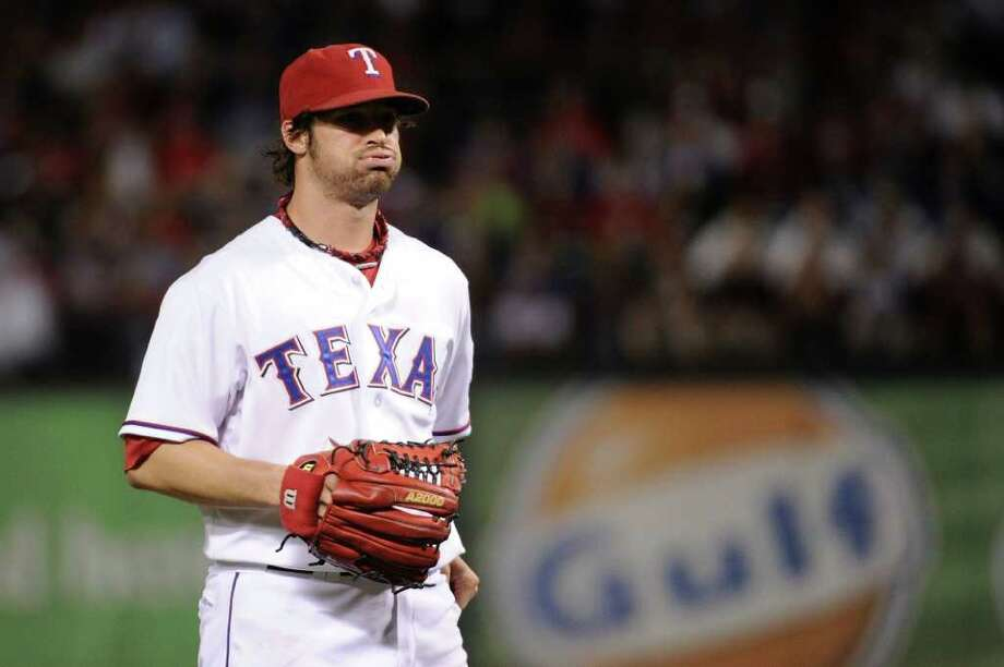 ARLINGTON, TX - OCTOBER 08:  C.J. Wilson #36 of the Texas Rangers reacts to a pitch against the Detroit Tigers in Game One of the American League Championship Series at Rangers Ballpark in Arlington on October 8, 2011 in Arlington, Texas. Photo: Harry How, Getty / 2011 Getty Images