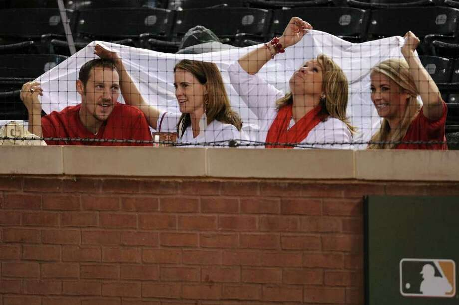ARLINGTON, TX - OCTOBER 08:  Fans sit in the stands during a rain delay in Game One of the American League Championship Series against the Detroit Tigers and the Texas Rangers at Rangers Ballpark in Arlington on October 8, 2011 in Arlington, Texas. Photo: Harry How, Getty / 2011 Getty Images