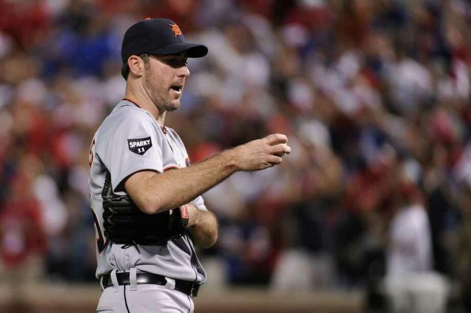 ARLINGTON, TX - OCTOBER 08:  Justin Verlander #35 of the Detroit Tigers reacts after allowing a home run to Nelson Cruz #17 of the Texas Rangers in the fourth inning of Game One of the American League Championship Series at Rangers Ballpark in Arlington on October 8, 2011 in Arlington, Texas. Photo: Harry How, Getty / 2011 Getty Images