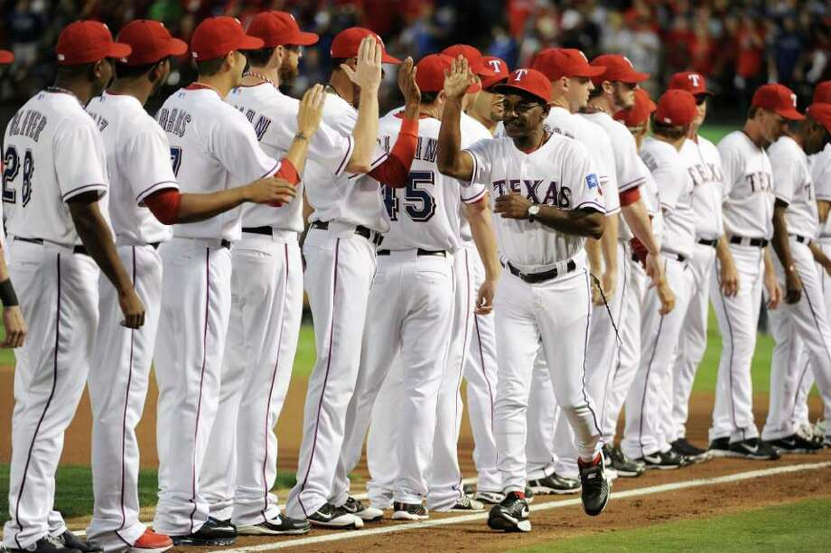 ARLINGTON, TX - OCTOBER 08:  Manager Ron Washington #38 of the Texas Rangers is introduced prior to Game One of the American League Championship Series against the Detroit Tigers at Rangers Ballpark in Arlington on October 8, 2011 in Arlington, Texas. Photo: Harry How, Getty / 2011 Getty Images