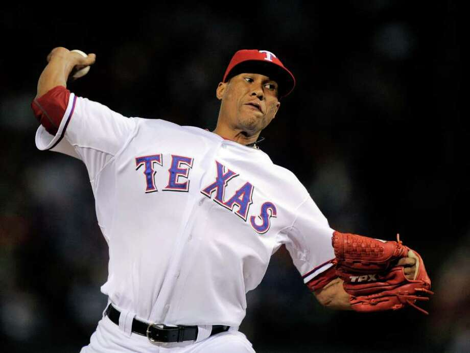 Texas Rangers' Alexi Ogando throws a pitch during the sixth inning at Game 1 of baseball's American League championship series against the Detroit Tigers Sunday, Oct. 9, 2011, in Arlington, Texas. (AP Photo/Mark J. Terrill) Photo: Mark J. Terrill, Associated Press / AP