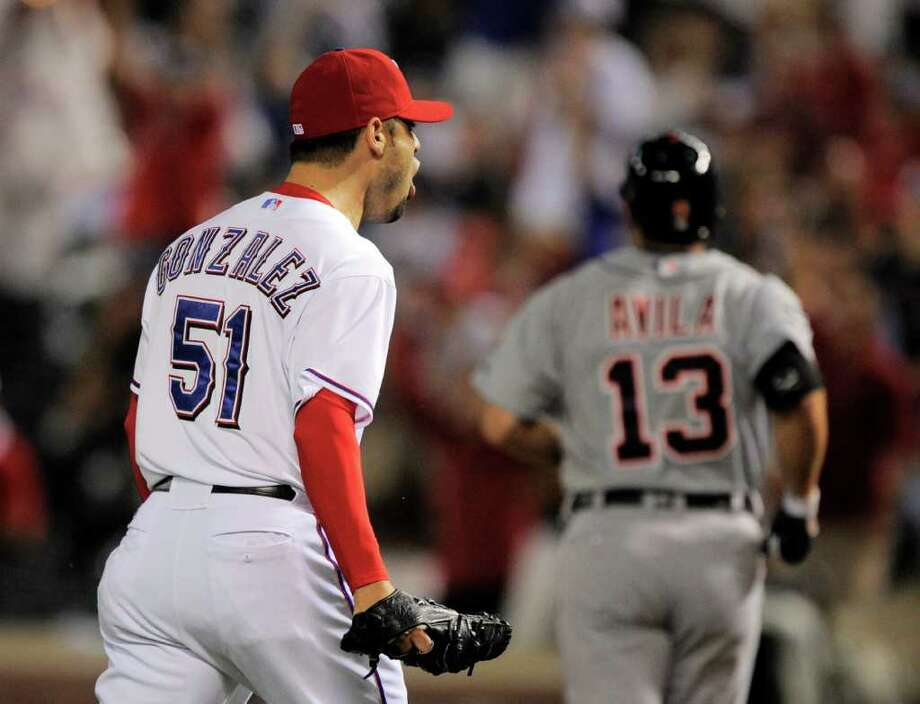 Texas Rangers relief pitcher Mike Gonzalez reacts to forcing a ground out from Detroit Tigers catcher Alex Avila to end the fifth inning during Game 1 of baseball's American League championship series Saturday, Oct. 8, 2011, in Arlington, Texas. (AP Photo/Mark J. Terrill) Photo: Mark J. Terrill, Associated Press / AP