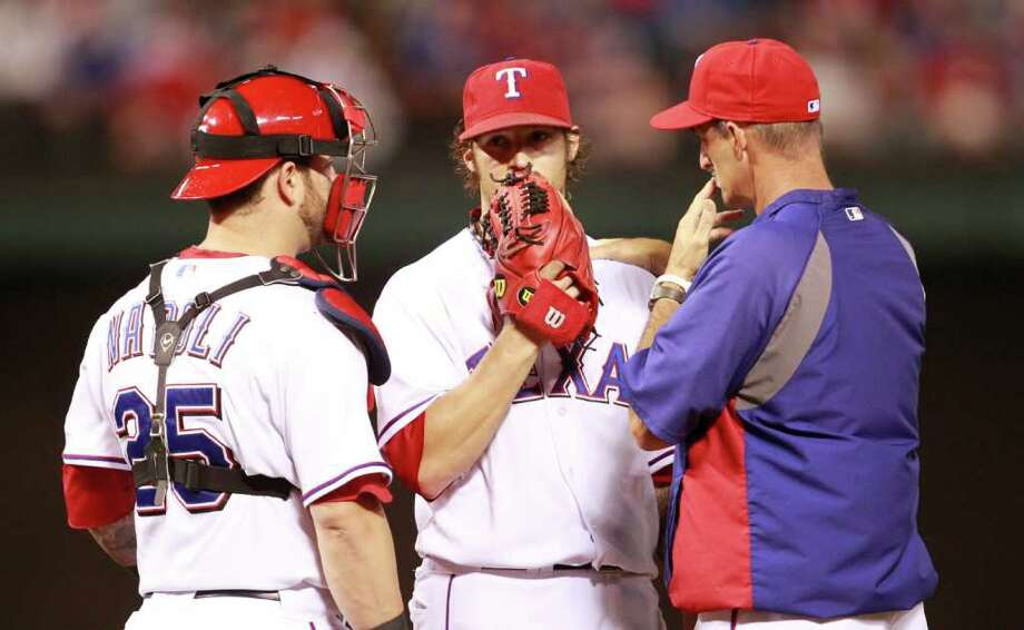 Texas Rangers catcher Mike Napoli, left, pitcher C.J. Wilson, center, and pitching coach Mike Maddux (31) in the fifth inning against the Detroit Tigers in Game 1 of the American League Championship Series at the Rangers Ballpark in Arlington, Texas, on Saturday, October 8, 2011. (Ron Jenkins/Fort Worth Star-Telegram/MCT) Photo: Ron Jenkins, McClatchy-Tribune News Service / Fort Worth Star-Telegram