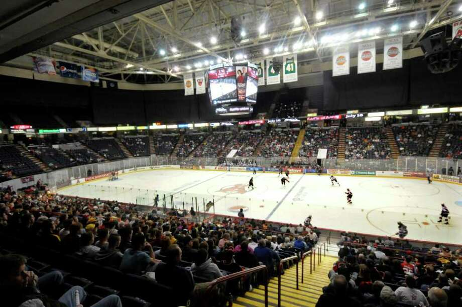 Hockey fans watch the Albany Devil's play the Portland Pirates' during the second period of their AHL hockey game at the Times Union Center in Albany, N.Y., Saturday, April 9, 2011. (Hans Pennink / Special to the Times Union) Pro Sports Photo: Hans Pennink / 00011283Z