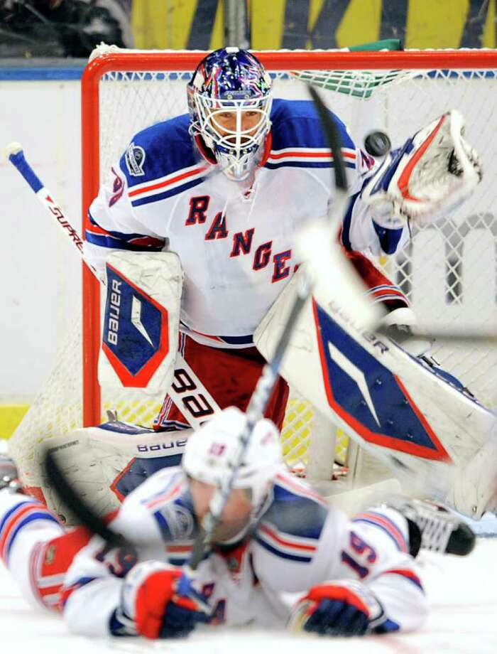 NY Rangers' goalie Henrik Lundqvist, back, makes a save during a NHL hockey match between Anaheim Ducks and NY Rangers in Stockholm, Sweden, Saturday, Oct. 8, 2011. (AP Photo/Niklas Larsson) Photo: NIKLAS LARSSON / AP