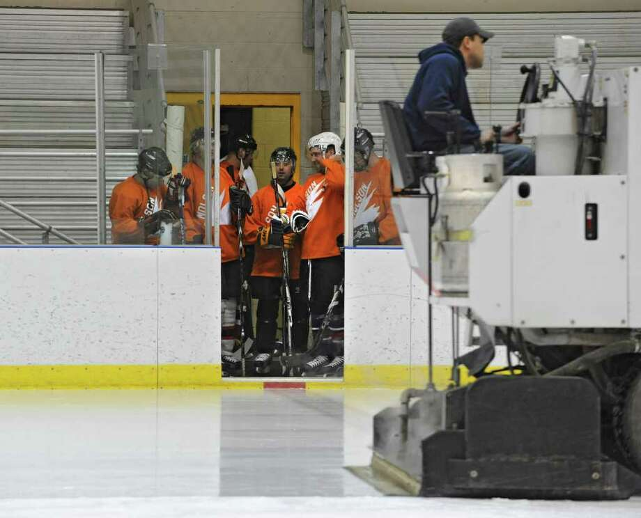 Men patiently wait for the Zamboni to resurface the ice before an adult men's hockey league game at Albany County Hockey Rink in Albany, N.Y. Wednesday, Oct. 5, 2011. (Lori Van Buren / Times Union) Photo: Lori Van Buren