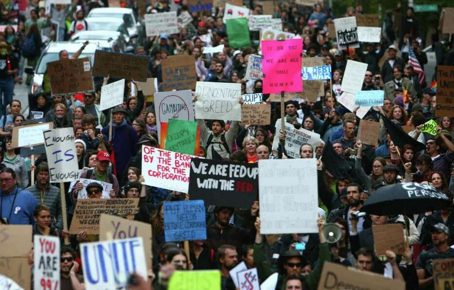 Thousands of Occupy Seattle protesters take to the streets of downtown Seattle during the second wee