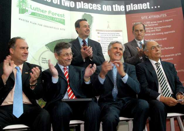Times Union staff photo by Cindy Schultz        Politicians applaud during the Advanced Micro Devices Inc. (AMD) news conference on Friday, June 23, 2006, at CESTM in Albany, N.Y. AMD will build a computer chip fab plant in Luther Forest in Stillwater. From left are John Sweeney, Sheldon Silver, Ron Canestrari, Joseph Bruno and Robert Riley. Joining them are Hector Ruiz, CEO and chairman of AMD, right. Photo: CINDY SCHULTZ / ALBANY TIMES UNION