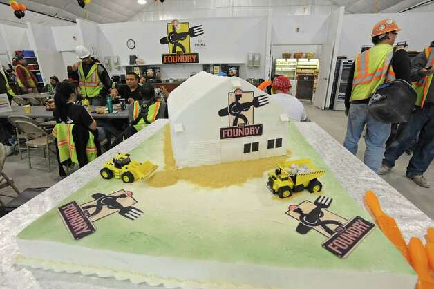 A huge cake sits waiting to be cut for workers inside The Foundry, at Globalfoundries in Malta, NY, during lunch time on February 15, 2011.  Angelo Mazzone Catering is celebrating the one-year anniversary of The Foundry, the on-site dining dome at Globalfoundries. It feeds 1,000 meals a day. (Lori Van Buren / Times Union) Photo: Lori Van Buren / 10012060A